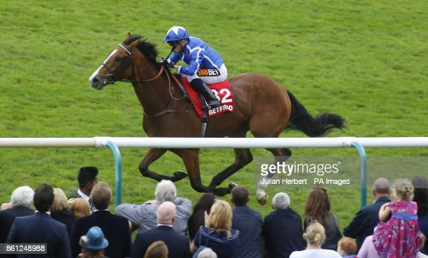 Withhold ridden by Silvestre De Sousa leads the field home to win The Betfred Cesarewitch Handicap Stakes Race run during day two of the Dubai Future...