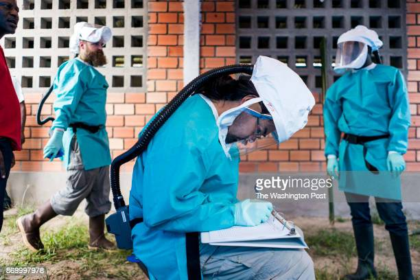 CONGO Within a field lab structure members of a Center of Disease Control research team CDC biologists Jeff Doty and Joshinori Nakazawa and Congolese...