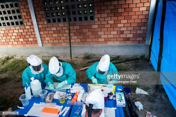 CONGO Within a field lab structure members of a Center of Disease Control research team Congolese scientists Lems Kalemba and Dr Fabien Kangoula as...
