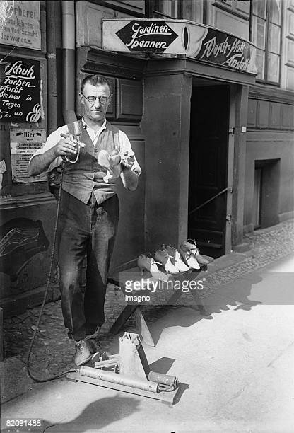 Within one minute old shoos can be colored with a special spraying method Photograph Around 1935 [Innerhalb einer Minute knnen alte Schuhe mittels...