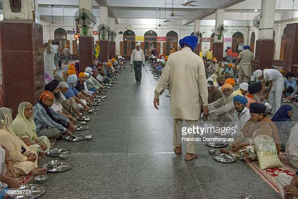 CONTENT] Within the premises of the Golden Temple pilgrims are served food free of charge prepared in large quantities by Sikh believers