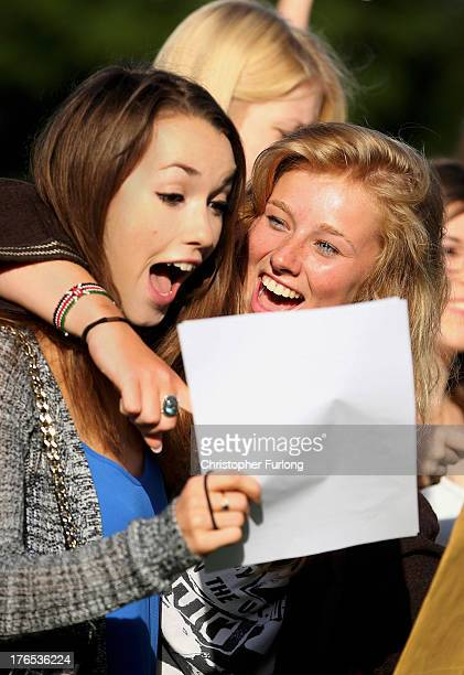 Withington Independent Girls School pupils Jennifer Flynn celebrates her two A* and three A's exam results with friend Harriet Macleod who achieved 4...