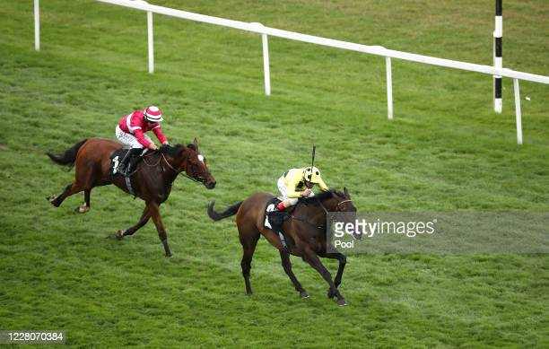 Without A Fight ridden by jockey Andrea Atzeni on their way to winning the Super Boosts From Unibet Novice Stakes race at Newbury Racecourse on...