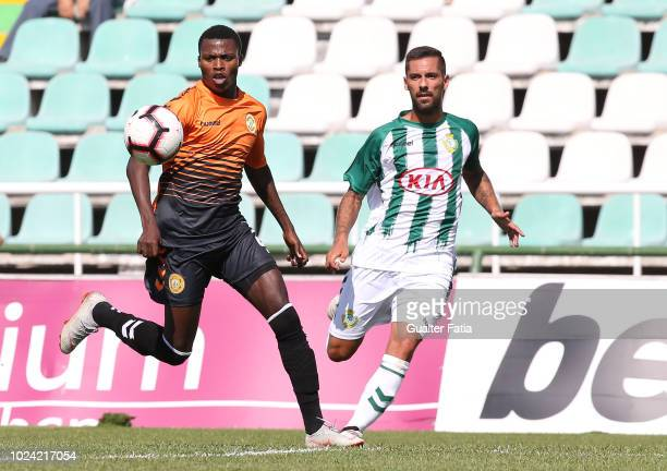 Witi Quembo of CD Nacional with Nuno Pinto of Vitoria FC in action during the Liga NOS match between Vitoria FC and CD Nacional at Estadio do Bonfim...