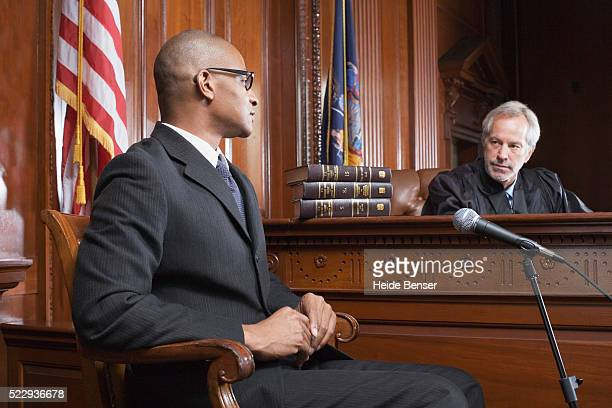 witness and judge talking during trial - legal trial stock pictures, royalty-free photos & images