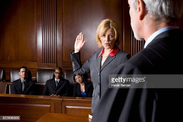 witness giving oath during trial - juror law stock pictures, royalty-free photos & images