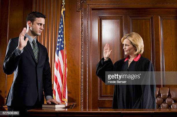 witness giving oath during trial - legal trial stock pictures, royalty-free photos & images