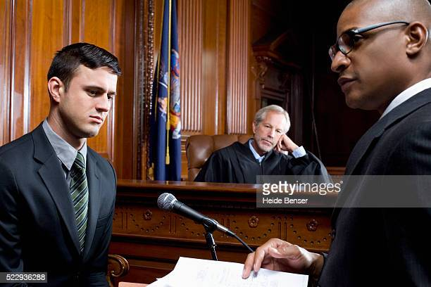 witness giving testimony during trial - legal trial stock pictures, royalty-free photos & images