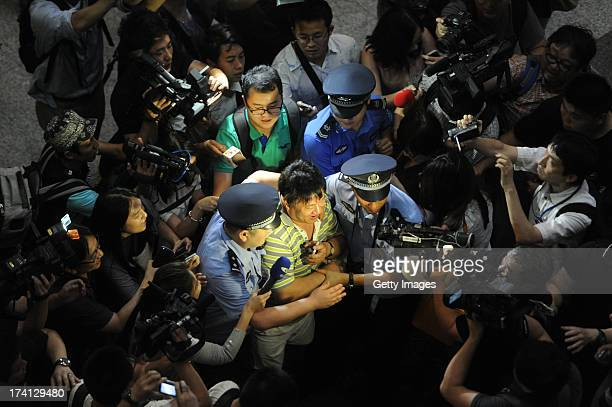 A witness is interviewed by the media at the Beijing Capital International Airport where an explosion occurred on July 20 2013 in Beijng China...