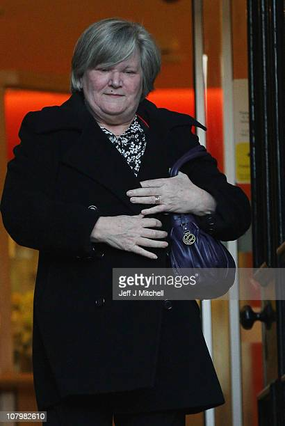 Witness Jean Telfer leaves Lanark Sheriff Court after giving evidence at the fatal accident inquiry into the helicopter crash that killed Colin McRae...