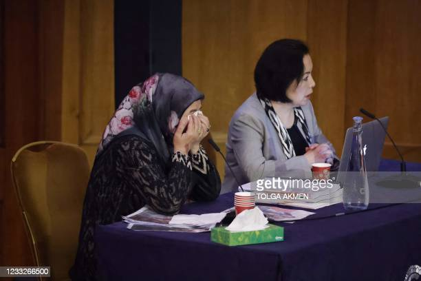 """Witness Patigul Talip reacts as she speaks on the first day of hearings at the """"Uyghur Tribunal"""", a panel of UK-based lawyers and rights experts..."""