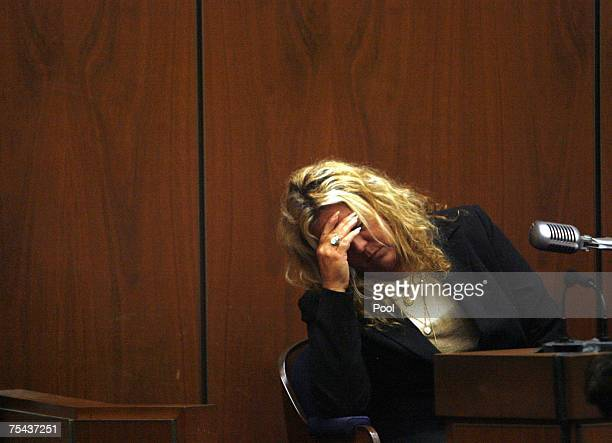 "Witness ""Punkin Pie"" Irene Elizabeth Laughlin, a friend of victim Lana Clarkson, pauses as she testifies in music producer Phil Spector's murder..."