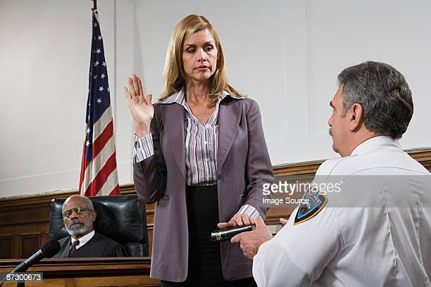 a witness swearing an oath - witness stock pictures, royalty-free photos & images