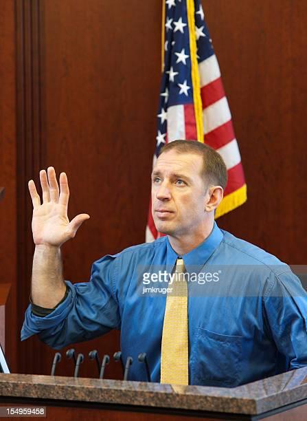 Witness taking oath in a trial