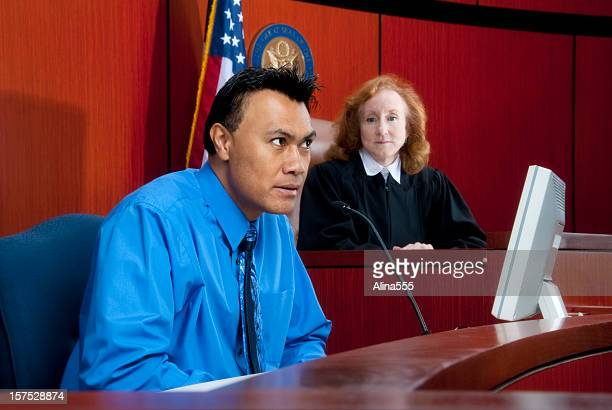 witness testifying at the stand in federal court, judge watching - defendant stock pictures, royalty-free photos & images