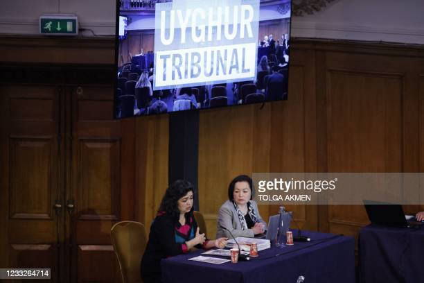 """Witness Uyghur teacher Qelbinur Sidik reacts as she speaks on the first day of hearings at the """"Uyghur Tribunal"""", a panel of UK-based lawyers and..."""