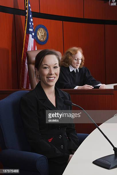 witness with female judge seated in courtroom - witness stock pictures, royalty-free photos & images