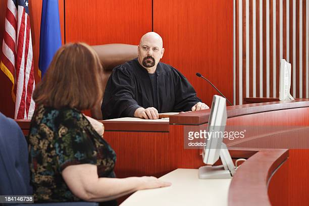 Witness with Judge Seated in Courtroom