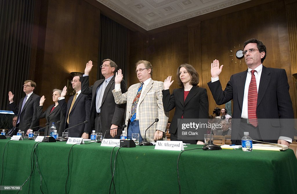 Witnesses are sworn in before testifying during the Senate Judiciary Committee Constitution, Civil Rights and Property Rights Subcommittee hearing on 'Secret Law and the Threat to Democratic and Accountable Government,' on Wednesday, April 30, 2008. From left are John P. Elwood, Deputy Assistant Attorney General Office of Legal Counsel, Dawn Johnsen, professor at Indiana University School of Law - Bloomington and former acting assistant attorney general in the Office of Legal Counsel, Bradford Berenson, partner at Sidley Austin LLP, William Leonard, former director of the Information Security Oversight Office, Leonardtown, Md., David Rivkin, partner at Baker Hostetler, Heidi Kitrosser, associate professor of law at the University of Minnesota Law School, and Steven Aftergood, director of the Federation of American Scientists' Project on Government Secrecy.