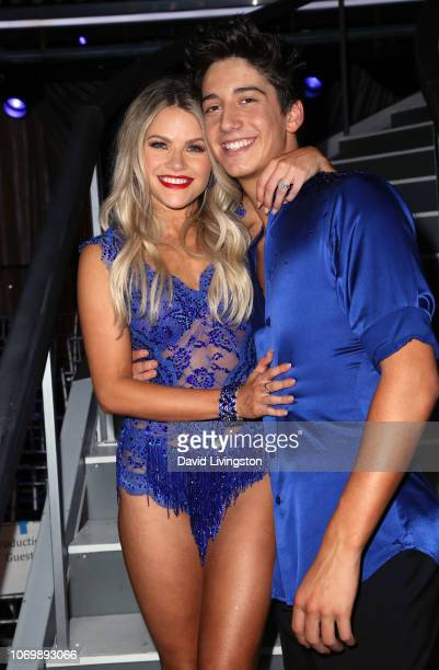 Witney Carson and Milo Manheim pose at 'Dancing with the Stars' Season 27 Finale at CBS Television City on November 19 2018 in Los Angeles California