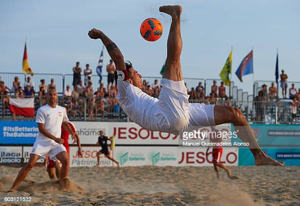 Witold Ziober of Poland attempts a scissor kick shot on goal during the FIFA Beach Soccer World Cup 2017 Qualifier Europe Jesolo 2016 final match...