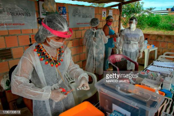 Witoto indigenous nursing assistant Vanda Ortega works at an improvised medical care unit at the Parque das Tribos indigenous neighbourhood, in...