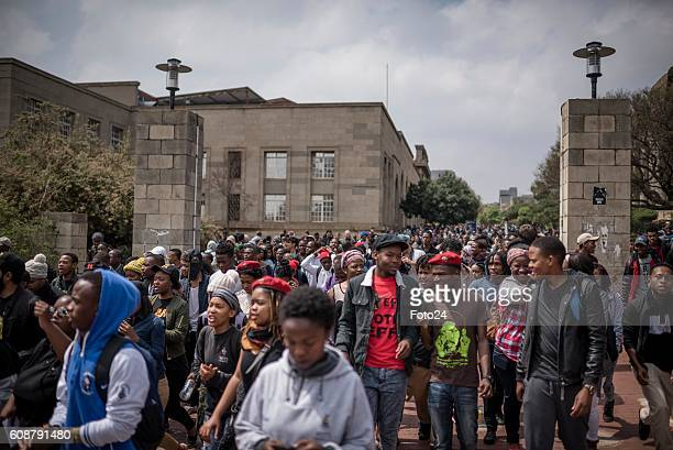 Wits University students block and barricade entrances to the institution during a #FeesMustFall protest on September 19 2016 in Johannesburg South...