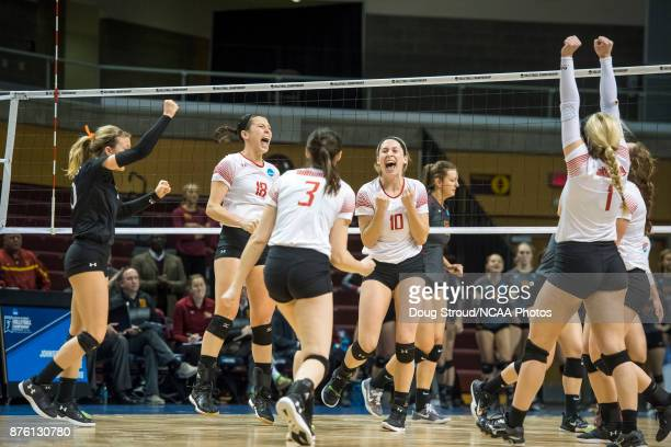 Wittenburg players Taylor Yontz Maddie Fischer Taylor Brown Aubrey Cox and Madison Manger celebrate after winning a the point against Claremont MS in...