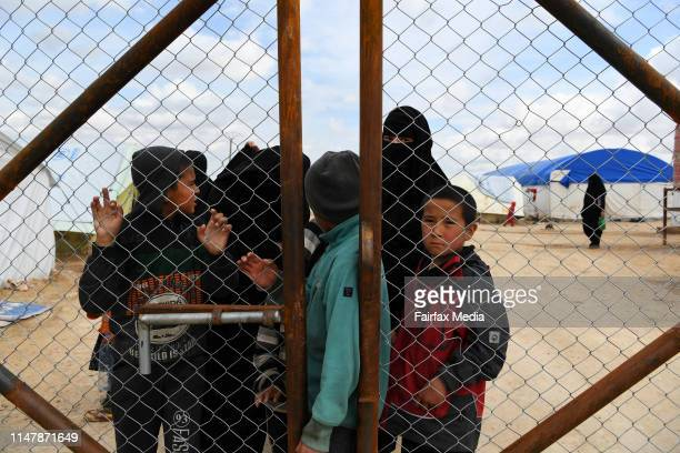 Wives and childern of former ISIS fighters gather at the fence in the foreign section of the al-Hawl refugee camp in northern Syria, waiting to be...