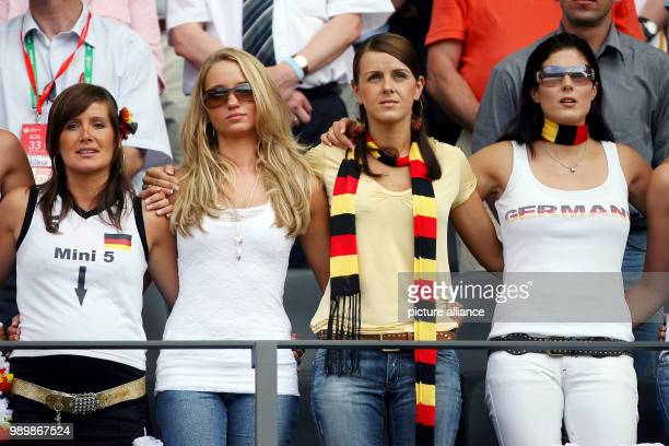 Wives and girlfriends of the German international football players Tina Monika Sylwia Klose and Petra Frings in the audience at the Olympia stadium...