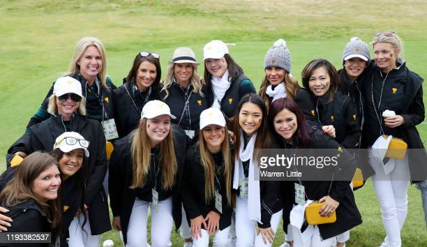 Wives and partners of members of the International team pose for a photo ahead of fourball matches on day one of the 2019 Presidents Cup at Royal...