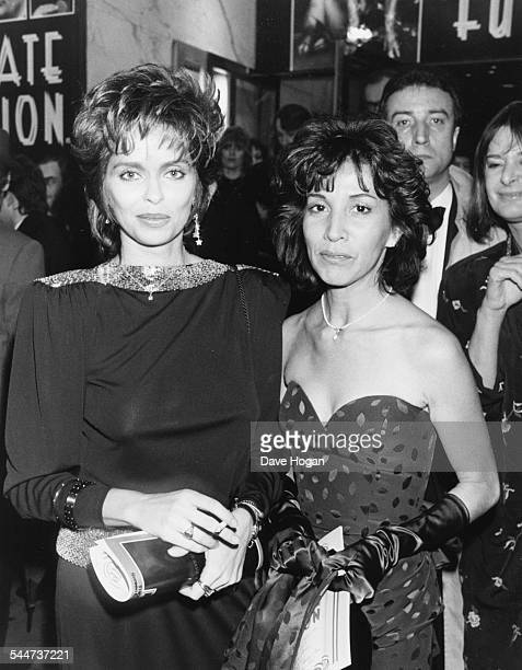 Wives of former 'The Beatles' members Olivia Harrison and Barbara Bach, attending the premiere of the film 'A Private Function' in London, November...