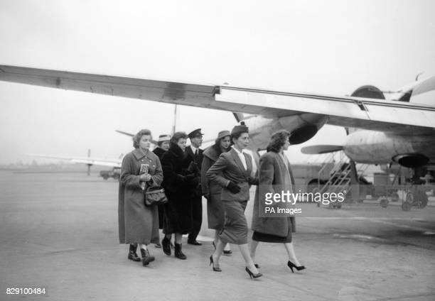 Wives of Manchester United players injured in the plane crash at Munichare pictured at Manchester Airpost before they fly to Munich Leading the group...