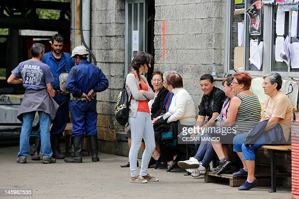 Wives of the seven Spanish coal miners who are spending their nineteenth day underground in a mine in Santa Cruz del Sil gather near the entrance of...