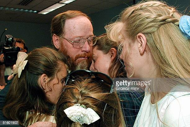 Wive's of Tom Green, Shirley, Linda and Hannah greet their husband a hug after he broke down and cried during a news conferance with reporters at the...