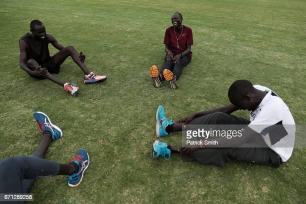 Wiyual Puok Deng Paulo Amotun Lokoro Dominic Lokinyomo Lobalu and Gai Nyang Tap of the Athlete Refugee Team practice prior to the IAAF / BTC World...