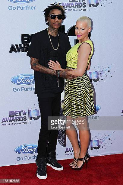 Wiz Khalifa and Amber Rose arrives at the 2013 BET Awards Make A Wish Arrivals at Nokia Plaza LA LIVE on June 30 2013 in Los Angeles California