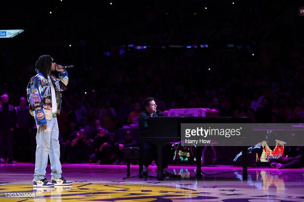 Wiz Khalifa and Charlie Puth sing 'See You Again' as a tribute to Kobe Bryant during halftime of the game between the Portland Trail Blazers and the...