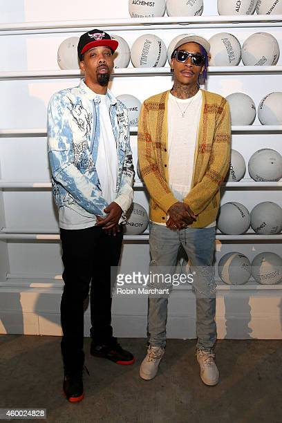 Wiz Khalifa and Chevy Woods attend Snarkitecture vs Alchemist and Alfa Romeo celebrate AIRBALL at 1111 Lincoln Road on December 5 2014 in Miami...