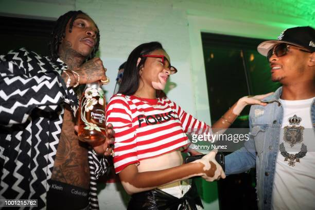 Wiz Khalifa and Winnie Harlow and TI attend the Wiz Khalifa album release party on July 17 2018 in New York City