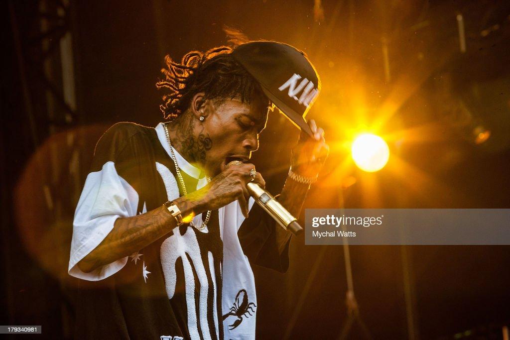 Wiz Khalifa performs during the 2013 Budweiser Made In America Festival at Benjamin Franklin Parkway on September 1, 2013 in Philadelphia, Pennsylvania.