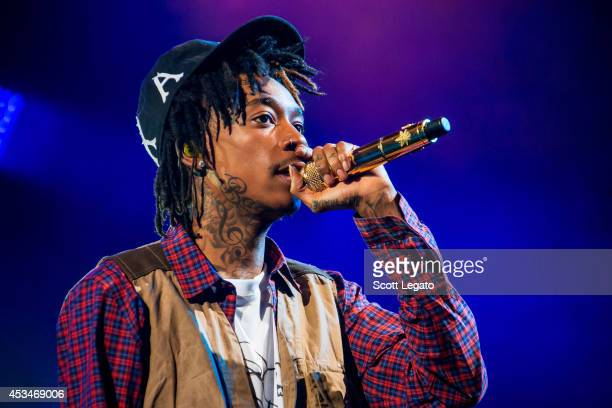 Wiz Khalifa performs during the Under the Influence of Music Tour at DTE Energy Music Theater on August 10 2014 in Clarkston Michigan