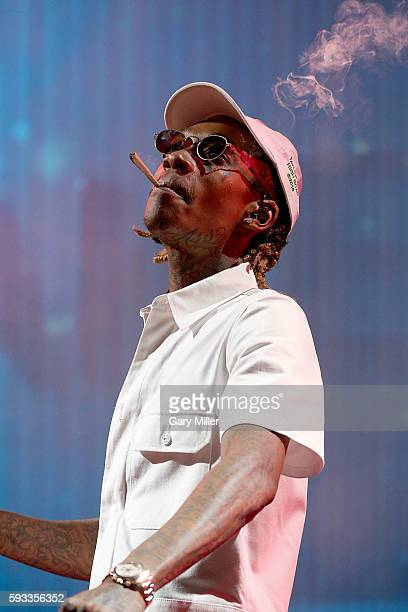 Wiz Khalifa performs in concert with Snoop Dogg on the High Road Tour at the Austin360 Amphitheater on August 21 2016 in Austin Texas