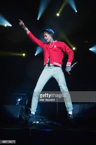 Wiz Khalifa performs on stage during Snoop's Wellness Retreat at WaMu Theater on April 19 2014 in Seattle Washington