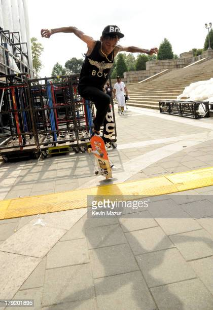 Wiz Khalifa skateboards backstage during the 2013 Budweiser Made In America Festival at Benjamin Franklin Parkway on September 1 2013 in Philadelphia...