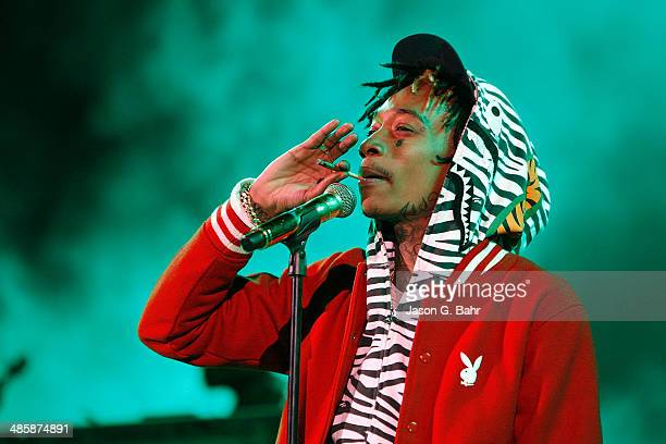 Wiz Khalifa smokes while performing at Red Rocks Amphitheatre on April 20 2014 in Morrison Colorado