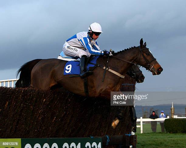 Wizard of Edge ridden by Timmy Murphy clears a fence enroute to winning the Weatherbys Bank Silver Buck Handicap Chase at Wincanton racecourse on...