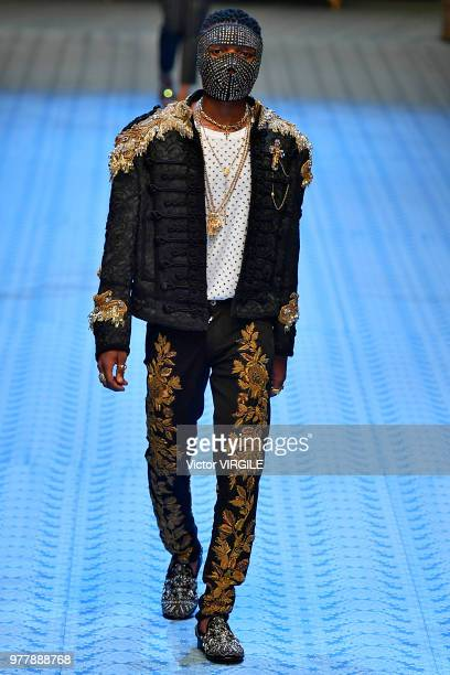 Wizkid walks the runway at the Dolce Gabbana fashion show during Milan Men's Fashion Week Spring/Summer 2019 on June 16 2018 in Milan Italy