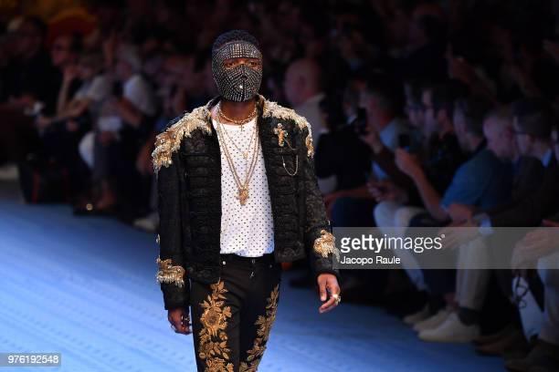 Wizkid walks the runway at the Dolce Gabbana show during Milan Men's Fashion Week Spring/Summer 2019 on June 16 2018 in Milan Italy