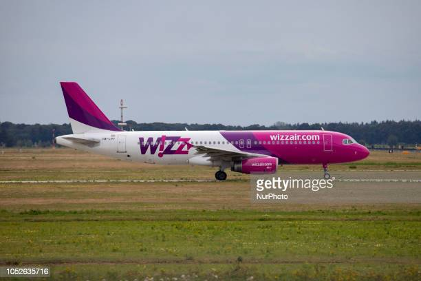 Wizz Air Airbus A320200 with registration HALPY Taxiing in Eindhoven airport Netherlands Wizz Air is a Hungarian low cost airline with a fleet of 104...
